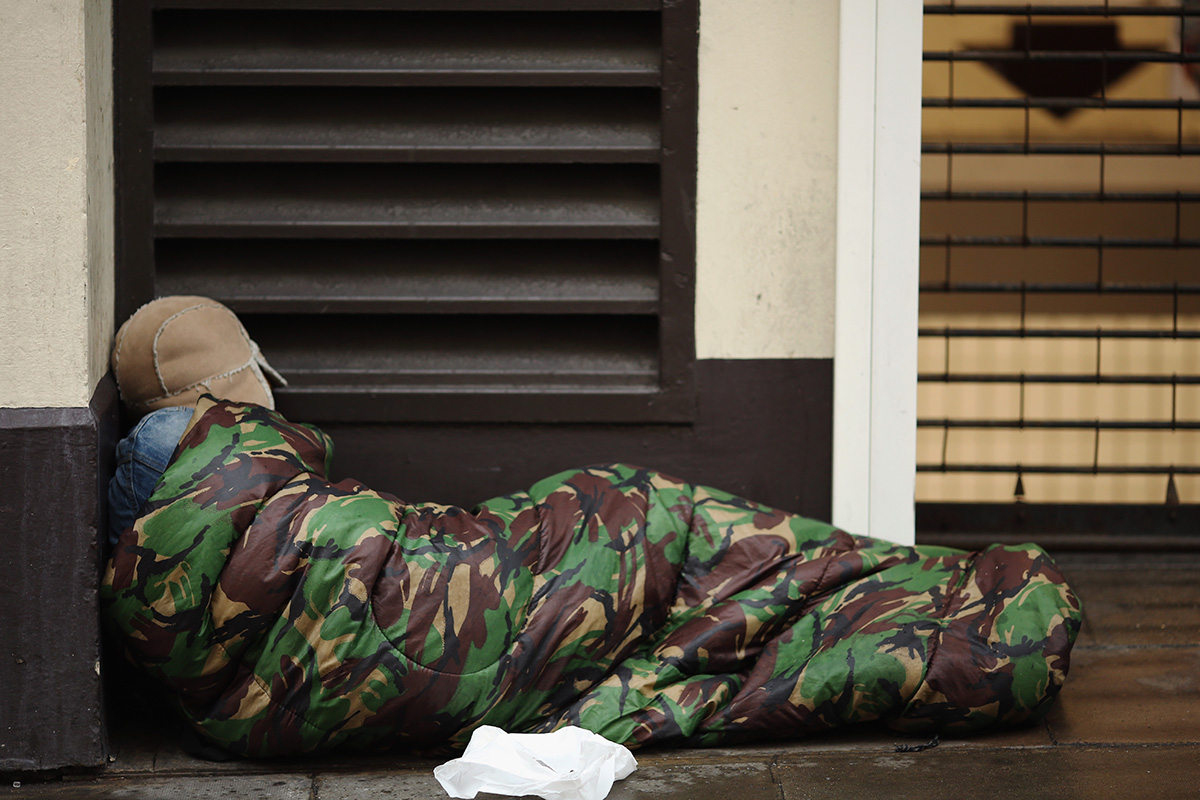 A homeless man sleeps near Trafalgar Square on January 27, 2016 (Photo by Dan Kitwood/Getty Images)