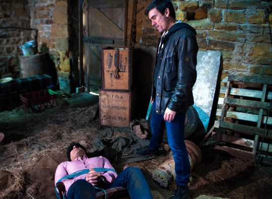 FROM ITV STRICT EMBARGO - No Use Before Tuesday 3 May 2016 Emmerdale - Ep 7498 Tuesday 10 May 2016  In a barn, Cain Dingle [JEFF HORDLEY] has tied Rakesh Kotecha [PACHA BOCARIE] to a chair. Rakesh awakes and begins calling for help. Meanwhile, Cain ignores Priya's call on Rakesh's phone and he's obviously enjoying himself as he reassures Holly she's done the right thing telling him about Belle. However, Charity covers her alarm when she hears Belle's been out all night with her boyfriend, realising Cain's got the wrong guy.   Picture contact: david.crook@itv.com on 0161 952 6214 Photographer - Andrew Boyce This photograph is (C) ITV Plc and can only be reproduced for editorial purposes directly in connection with the programme or event mentioned above, or ITV plc. Once made available by ITV plc Picture Desk, this photograph can be reproduced once only up until the transmission [TX] date and no reproduction fee will be charged. Any subsequent usage may incur a fee. This photograph must not be manipulated [excluding basic cropping] in a manner which alters the visual appearance of the person photographed deemed detrimental or inappropriate by ITV plc Picture Desk. This photograph must not be syndicated to any other company, publication or website, or permanently archived, without the express written permission of ITV Plc Picture Desk. Full Terms and conditions are available on the website www.itvpictur
