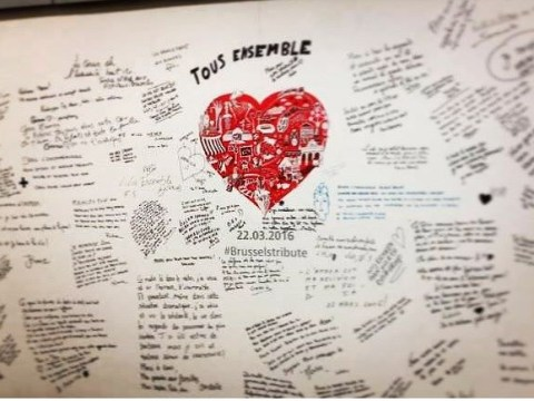 Commuters write tributes on the walls as Brussels station re-opens after attacks