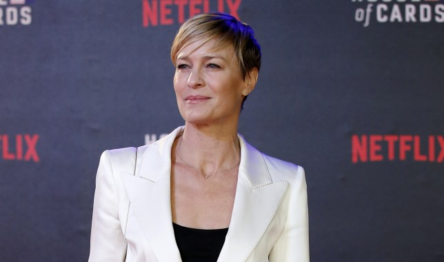 US actress Robin Wright poses for photographers on the red carpet ahead of the world premiere of the television series 'House of Cards - Season 3 Episode 1' in London on February 26, 2015. AFP PHOTO / JUSTIN TALLIS (Photo credit should read JUSTIN TALLIS/AFP/Getty Images)