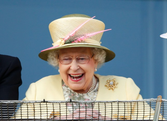 EPSOM, UNITED KINGDOM - JUNE 06: (EMBARGOED FOR PUBLICATION IN UK NEWSPAPERS UNTIL 48 HOURS AFTER CREATE DATE AND TIME) Queen Elizabeth II watches the racing from the balcony of the Royal Box as she attends Derby Day during the Investec Derby Festival at Epsom Racecourse on June 6, 2015 in Epsom, England. (Photo by Max Mumby/Indigo/Getty Images)