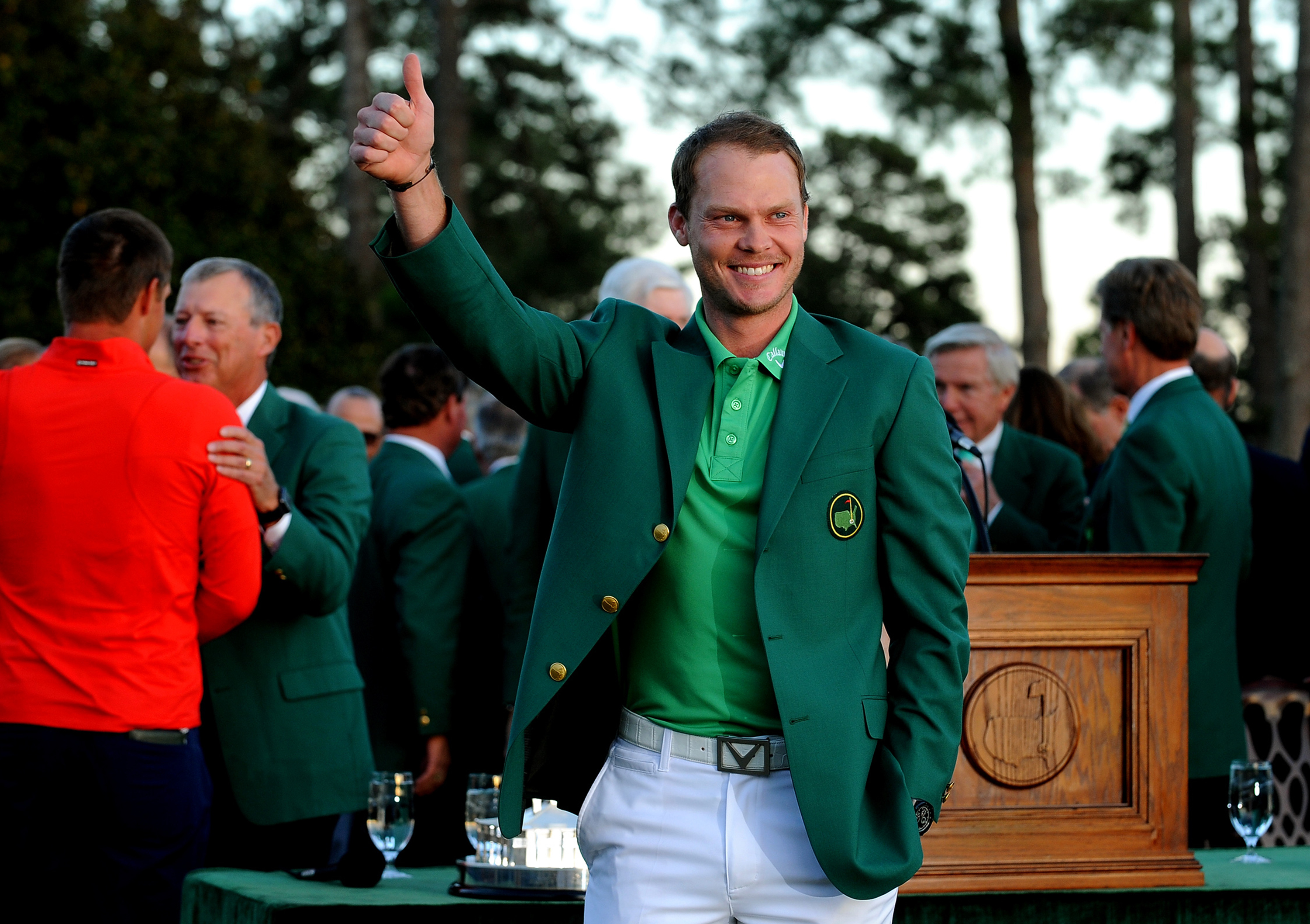 Masters champion Danny Willett smiles and gives the thumbs up after receiving his green jacket from 2015 champion Jordan Spieth on Sunday, April 10, 2016, at Augusta National Golf Club in Augusta, Ga. (Jeff Siner/Charlotte Observer/TNS via Getty Images)