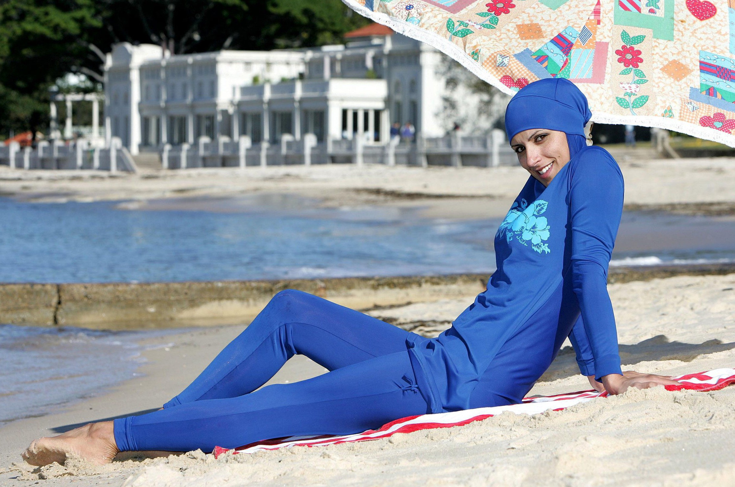 "Mandatory Credit: Photo by REX/Shutterstock (672445e)nThe ""Burqini"" Swimsuit, a revolution in swimwear design for Muslim women. Designed by Aheda Zanetti from Sydney, Australia, the ""Burqini"" preserves modesty of dress whilst being made of a lightweight, quickdrying, UV-protecting fabric.nThe 'Burqini' swimsuit for Muslim women, Sydney, Australia - 21 Jun 2007nn"