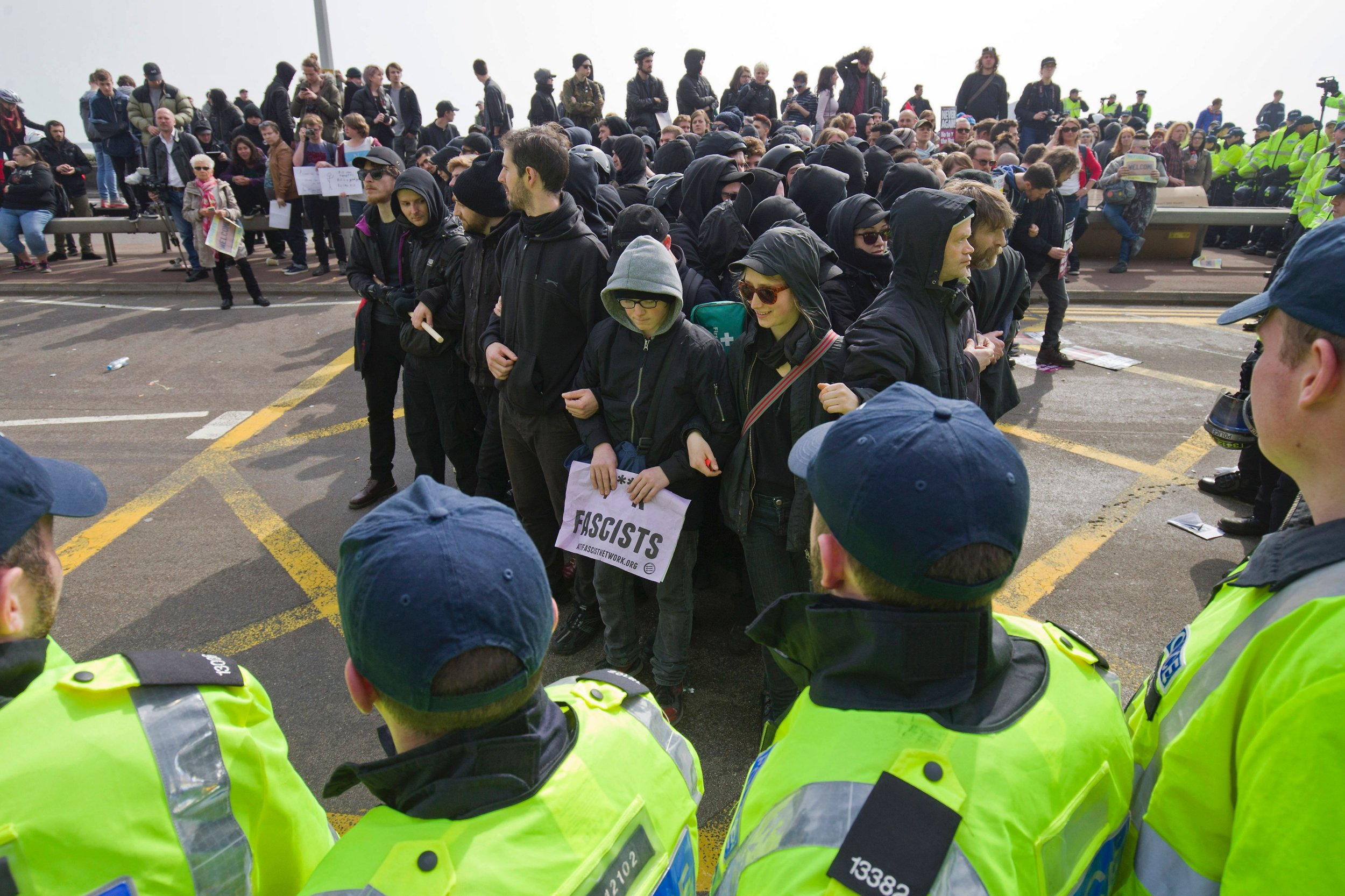 Police surround anti-racism demonstrators as they block the route of a planned far right march through Dover, southern England, on April 2, 2016. / AFP PHOTO / JUSTIN TALLISJUSTIN TALLIS/AFP/Getty Images