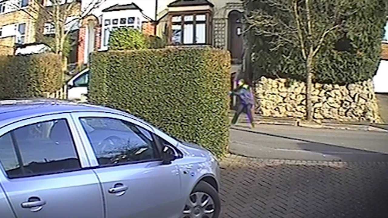 CCTV of the moment a delivery driver was knocked over by a thief stealing her van after she made a delivery and left the keys in the ignition in Biggin Hill, South London. See SWNS story SWVAN; This is the moment a young courier was hit with her own van as she bravely tried to stop a sneak thief from stealing it. The 22-year-old had left the keys in the ignition of her white Ford Transit as she delivered a parcel in Biggin Hill, South London. But she approached the property, an opportunist thief jumped into the unattended van and tried to drive off. The woman dashed back and stepped into the road but the thief hit her at speed and sent her flying into the air. She was left with a shattered kneecap and broken ankle requiring multiple operations and a lengthy stay in hospital.
