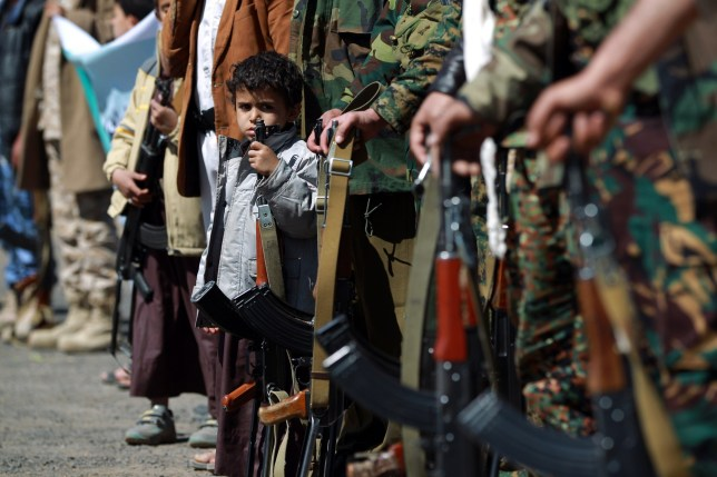 Yemeni children hold automatic rifles as they join grown up relatives in a tribal gathering organised by the Shiite Huthi movement in Sanaa on February 4, 2015 in support of the militia which overran the Yemeni capital in September. The Huthis later seized the presidential palace and key government buildings on January 20, plunging the country deeper into crisis and prompting President Abedrabbo Mansour Hadi and his premier to tender their resignations. AFP PHOTO / MOHAMMED HUWAIS (Photo credit should read MOHAMMED HUWAIS/AFP/Getty Images)