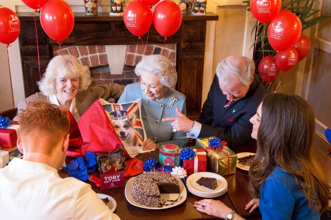 The nationís reigning monarch started her 90th birthday celebrations early with a trip to her local Toby Carvery this week to indulge in an iconic great British roast dinner. But all is not as it seems as the home-video-style footage, shot from Prince Williamís perspective, was created by BAFTA award-winning celebrity artist, Alison Jackson, to show how the royal family might be celebrating this landmark occasion. The candid clip features the royal family enjoying a birthday celebration. Kate is seen setting the table with the Toby Carvery team, while Prince Charles asks the chef for a ëkingí-size portion, much to his motherís dismay who remarks ìnot likely!î After roast dinners all round, the Queen is presented with a celebration cake complete with a ë90í candle and a card from Toby Carvery. Finally, Her Royal Highness opens presents including a very British corgi cushion...
