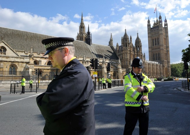 FMTXHH epa02341025 Police officers stand on duty before Westminster Abbey in London, Britain, 17 September 2010, where Pope Benedict XVI will participate in the celebration of an evening prayer at 18.15 local time, during the second day of his visit to the UK. P