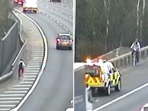 Over-enthusiastic cyclist tries to ride bike on M25