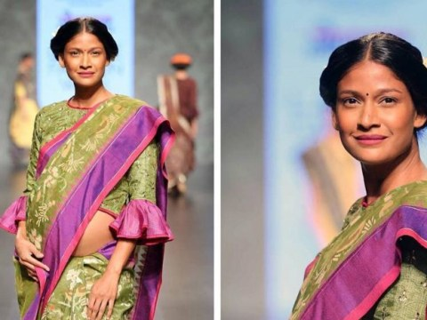 Indian supermodel walks the runway while pregnant. Nails it.