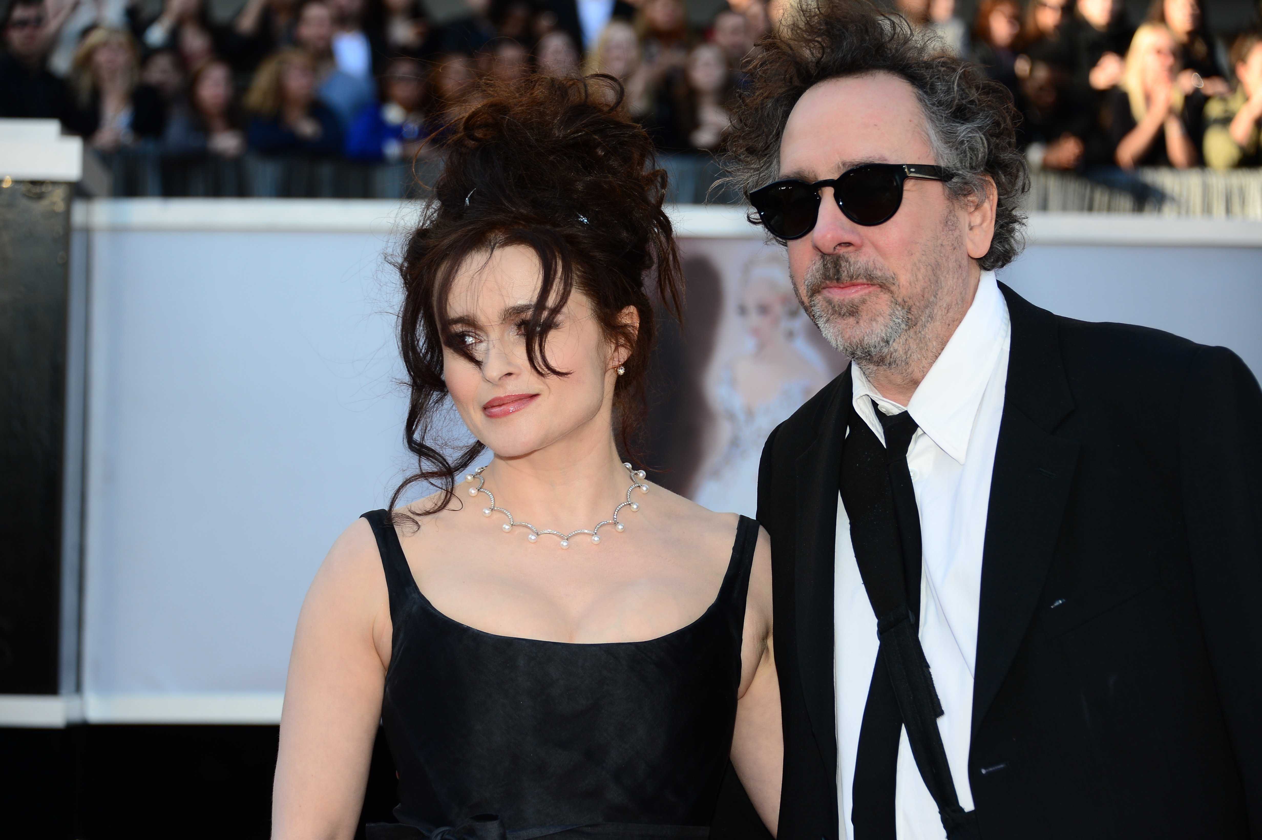 Actress Helena Bonham Carter and Director Tim Burton arrive on the red carpet for the 85th Annual Academy Awards on February 24, 2013 in Hollywood, California. AFP PHOTO/FREDERIC J. BROWN (Photo credit should read FREDERIC J. BROWN/AFP/Getty Images)