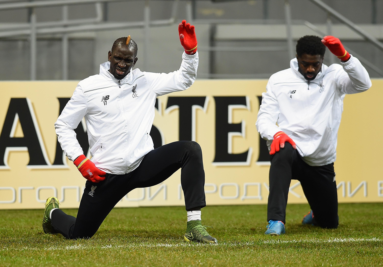 Liverpool ace Kolo Toure helping Mamadou Sakho after failed drugs test
