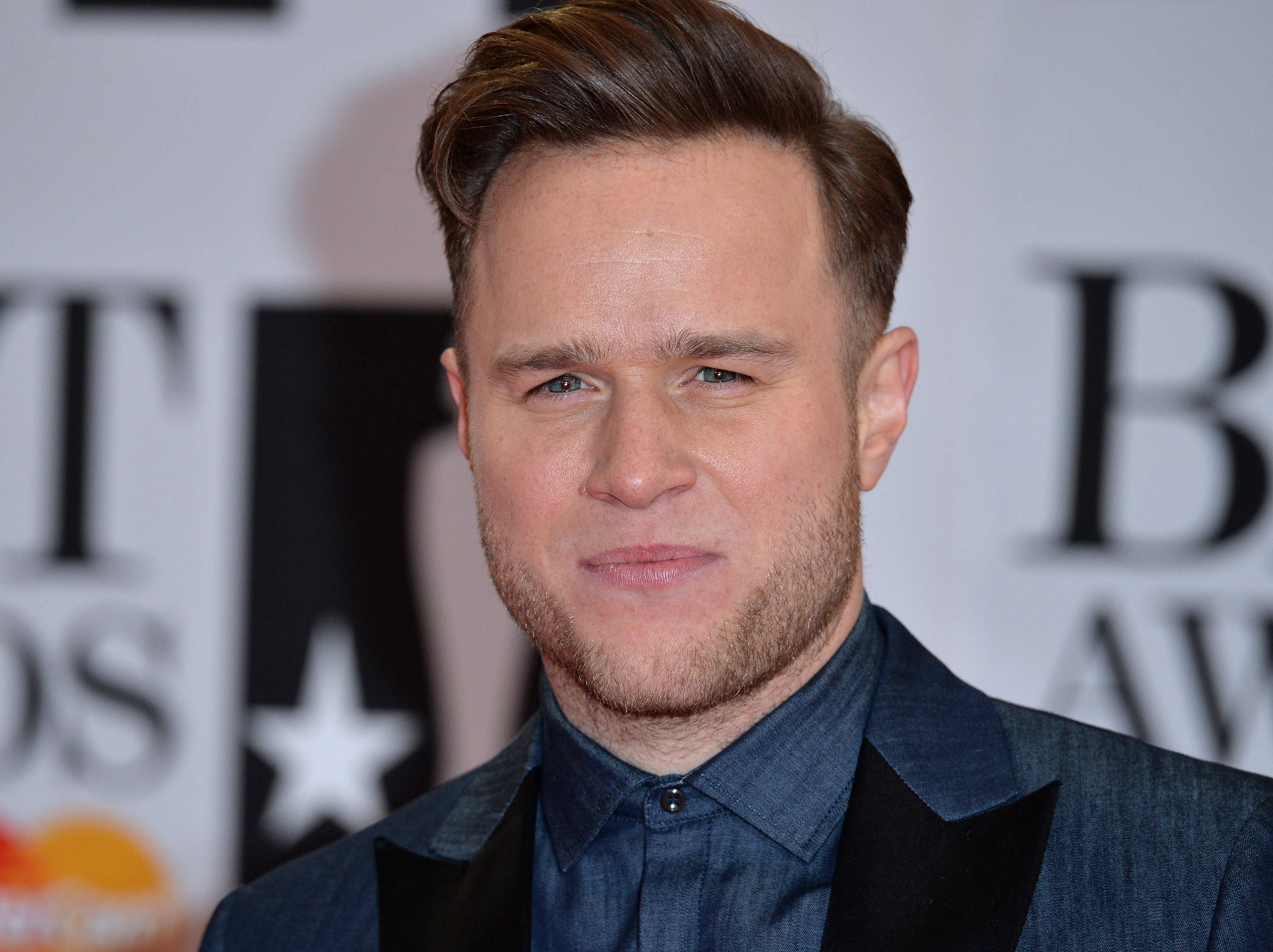 LONDON, ENGLAND - FEBRUARY 24: Olly Murs attends the BRIT Awards 2016 at The O2 Arena on February 24, 2016 in London, England. (Photo by Anthony Harvey/Getty Images)