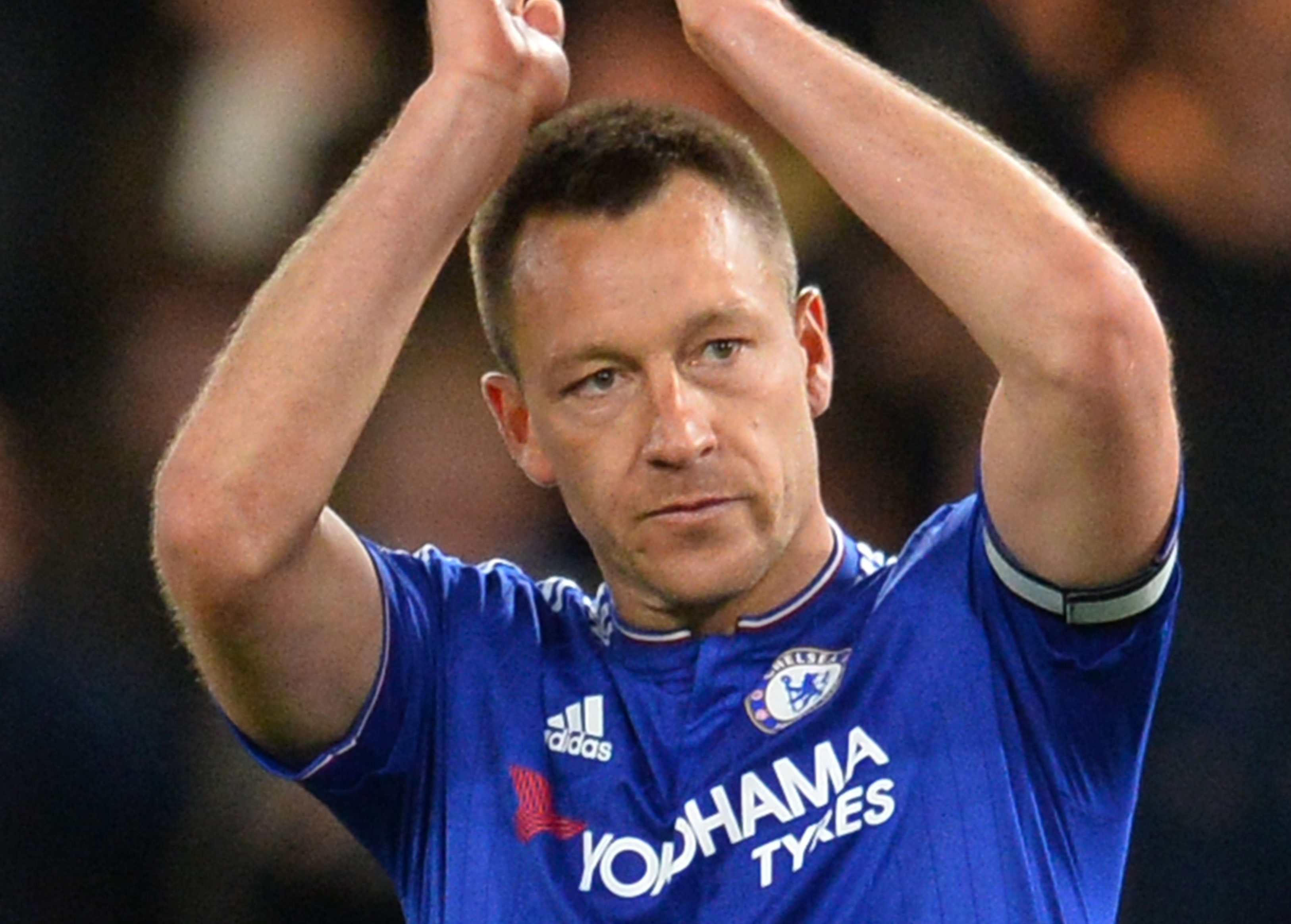 Chelsea's English defender John Terry applauds at the end of the English Premier League football match between Chelsea and Tottenham Hotspur at Stamford Bridge in London on May 2, 2016. / AFP / GLYN KIRK / RESTRICTED TO EDITORIAL USE. No use with unauthorized audio, video, data, fixture lists, club/league logos or 'live' services. Online in-match use limited to 75 images, no video emulation. No use in betting, games or single club/league/player publications. / (Photo credit should read GLYN KIRK/AFP/Getty Images)