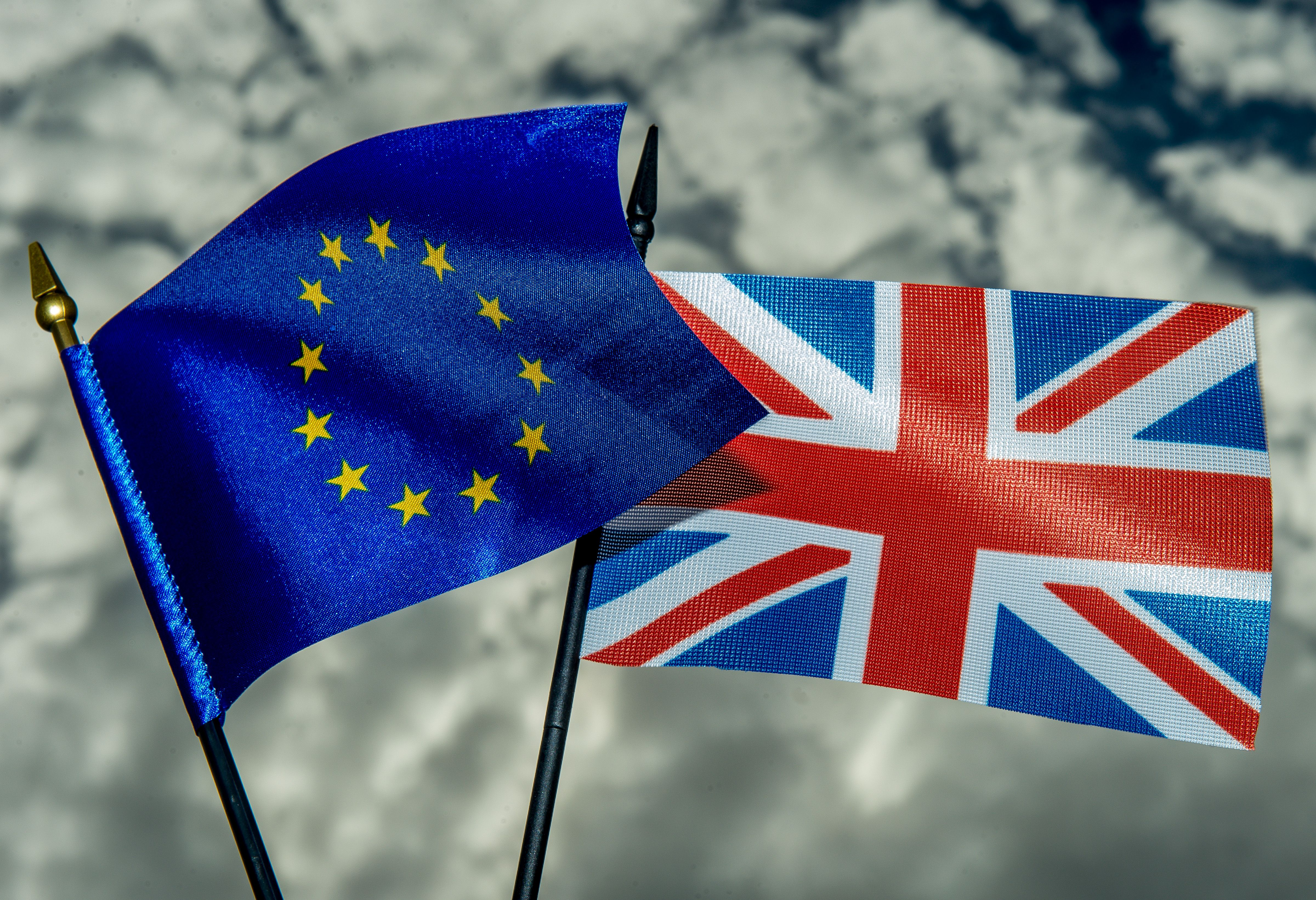 """This photo illustration created on May 20, 2016 in Lille shows the flags of the European Union and the United Kingdom. On June 23, 2016 Great Britain will hold a referendum on whether or not the United Kingdom will remain within the European Union, often referred to as """"Brexit."""" Group of Seven finance ministers on May 21 warned of the risks from a """"shock"""" to the world economy if Britain votes to leave the European Union next month. / AFP / PHILIPPE HUGUEN (Photo credit should read PHILIPPE HUGUEN/AFP/Getty Images)"""