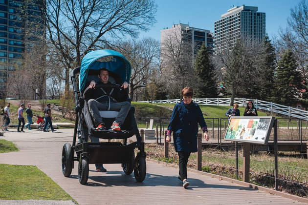 Seven foot pram lets adults stroll around like babies