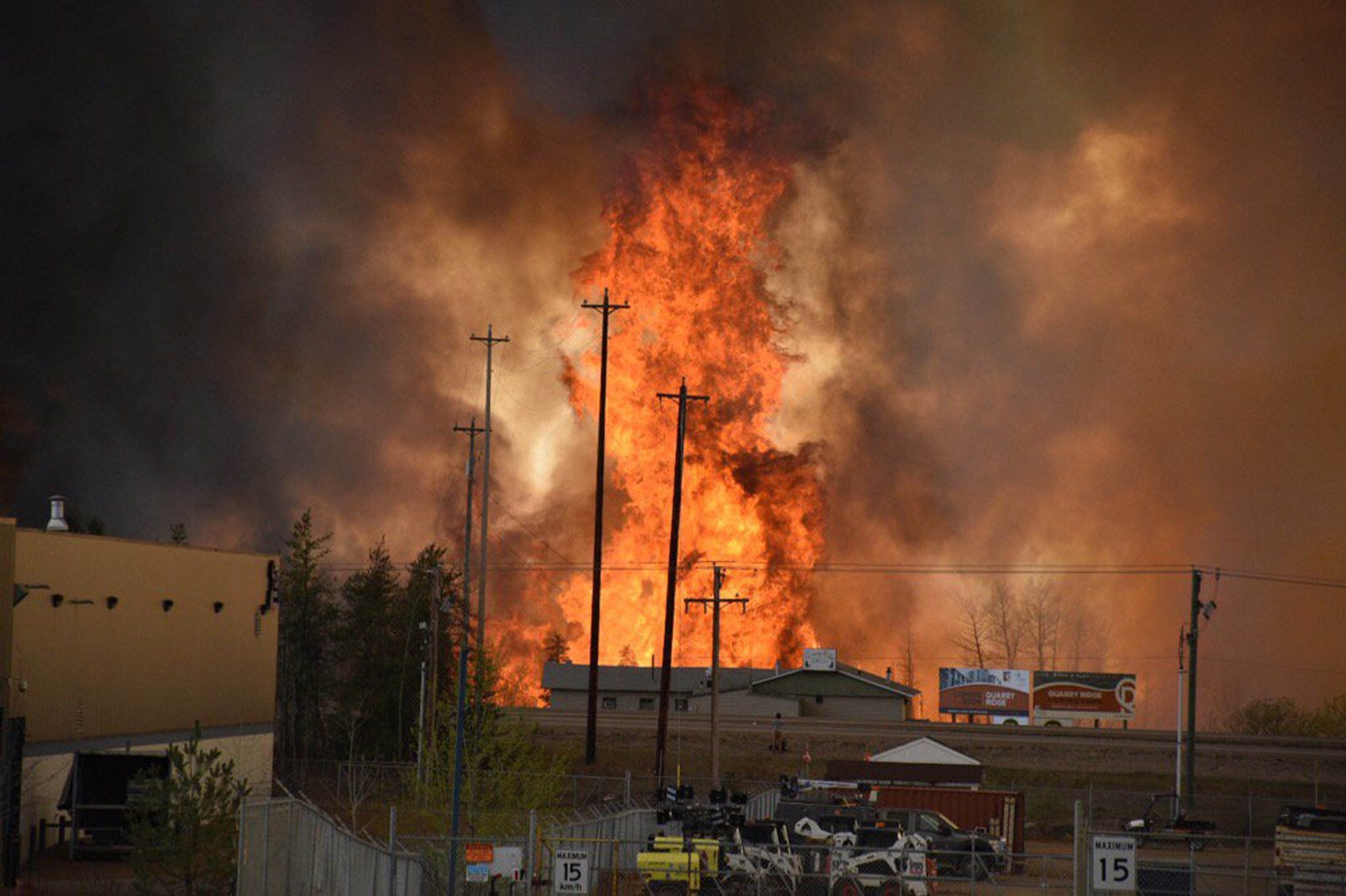 Flames rise in Industrial area south Fort McMurray, Alberta Canada May 3, 2016. The whole city of Fort McMurray, Alberta, the gateway to Canada's oil sands region, is under a mandatory evacuation order because of an uncontrolled wildfire that is rapidly spreading, local authorities said on Tuesday. Courtesy CBC News/Handout via REUTERS ATTENTION EDITORS - THIS IMAGE WAS PROVIDED BY A THIRD PARTY. EDITORIAL USE ONLY. NO RESALES. NO ARCHIVE. MANDATORY CREDIT. ONE TIME USE ONLY