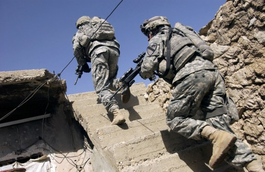 BFRDCG Soldiers running up staircase of a building during a mission in Mosul, Iraq.