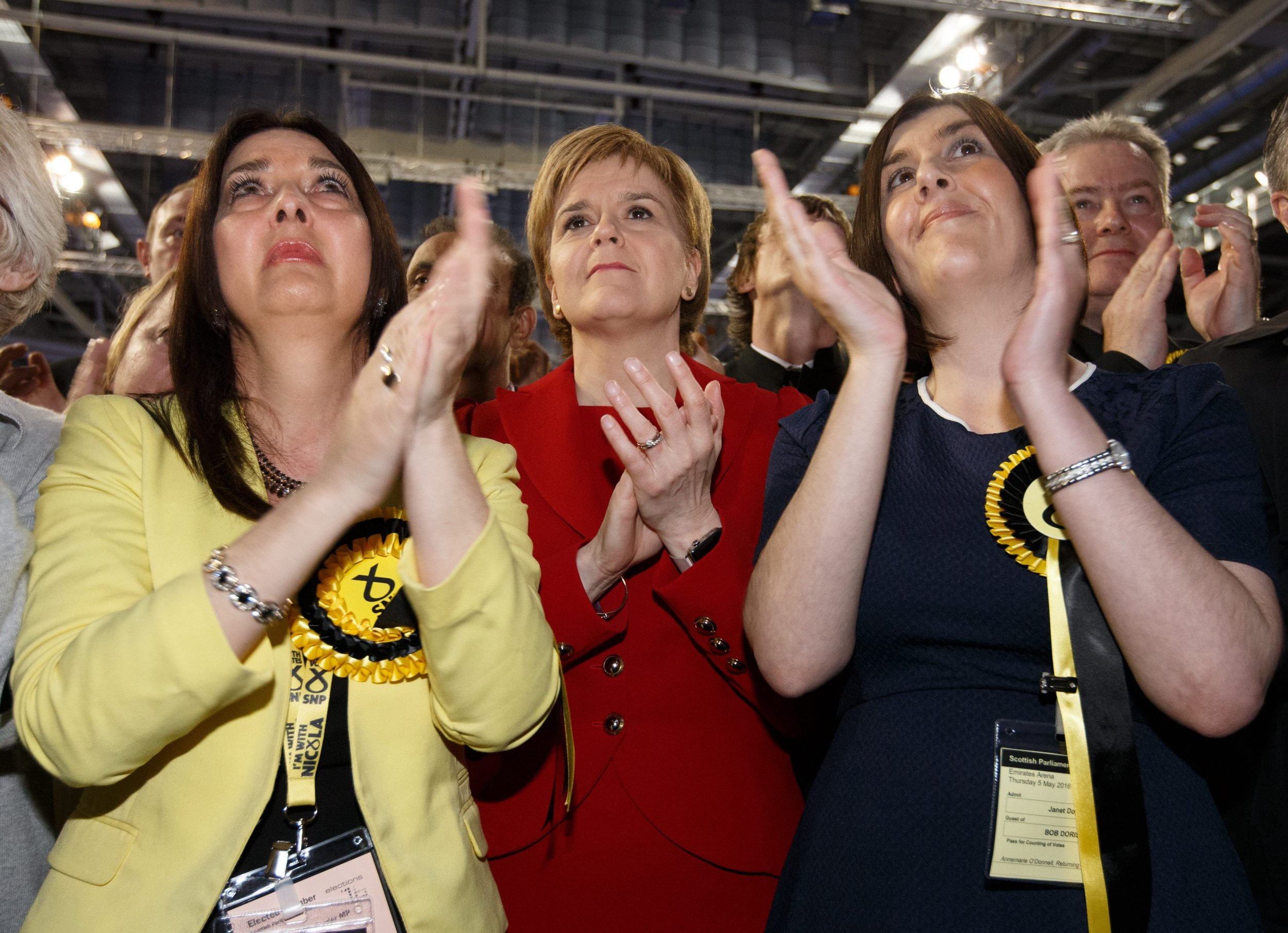 epa05291500 Leader of the Scottish National Party (SNP), Nicola Sturgeon embraces Margaret Ferrier (L), and Janet Doris (R) as her husband Bob Doris (unseen) speaks to the audience at the Emirates Arena in Glasgow, Scotland, Britain, 06 May 2016. The 2016 Scottish Parliament election, which elects 129 members to the Scottish Parliament, was held on 05 May 2016. EPA/ROBERT PERRY