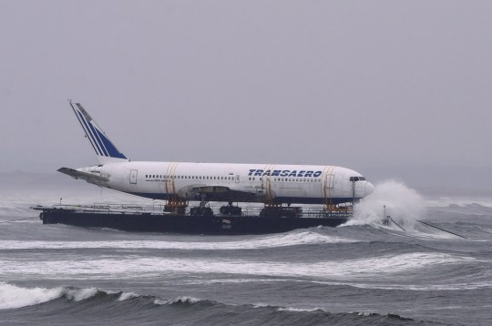 Bad weather surrounds a Boeing 767 airplane as it is prepared to be pulled ashore Enniscrone beach after it was tugged from Shannon airport out to sea around the west coast of Ireland, May 7, 2016. It is destined for local funeral director David McGowan's proposed Glamping Village to be used as accommodation in Sligo, Ireland. REUTERS/Clodagh Kilcoyne TPX IMAGES OF THE DAY