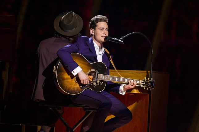 """STOCKHOLM, SWEDEN - MAY 10: Douwe Bob of The Netherlands performs the song """"Slow Down"""" during the semifinals of the 2016 Eurovision Song Contest at Ericsson Globe Arena on May 10, 2016 in Stockholm, Sweden. (Photo by Michael Campanella/Getty Images)"""