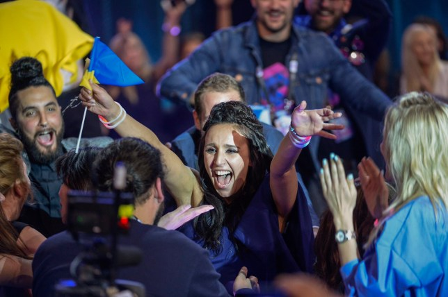 epa05306855 Ukraine's Jamala (C) reacts after winning the 61st annual Eurovision Song Contest (ESC) at the Ericsson Globe Arena in Stockholm, Sweden, 14 May 2016. There were 26 finalists from as many countries competing in the grand final. EPA/MAJA SUSLIN SWEDEN OUT