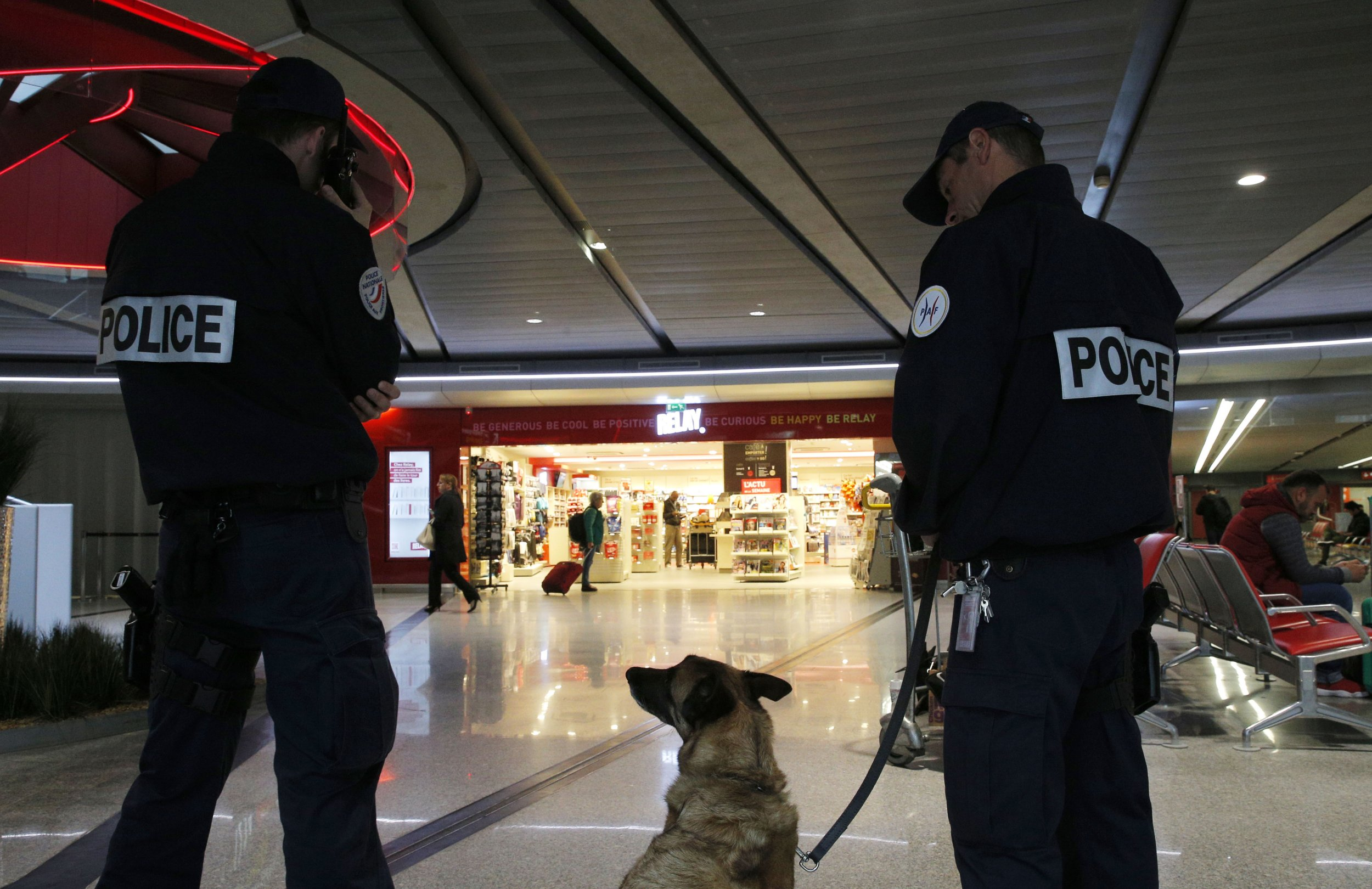 Police officers patrol at Charles de Gaulle airport, outside of Paris, Thursday, May 19, 2016. An EgyptAir flight from Paris to Cairo with 66 passengers and crew on board crashed into the Mediterranean Sea off the Greek island of Crete early Thursday morning, Egyptian and Greek officials said. (AP Photo/Christophe Ena)