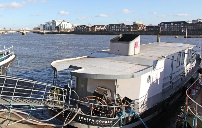 BNPS.co.uk (01202 558833) Pic: Riverhomes/BNPS Heart of Lightness - Tardis like houseboat on the Thames. A houseboat that looks more like a luxurious penthouse suite inside has gone on the market for a whopping £1.5 million - because it's in one of London's most exclusive locations. The 100ft vessel was once a former Dutch barge taking supplies up and down the Thames until it was retired from service in the 1960s and left to rot. But a decade later it was salvaged and turned into a houseboat before undergoing a complete refurbishment four years ago and moved to a premier mooring alongside one the swankiest addresses in the city. The plush houseboat, berthed at the entrance to Cheyne Walk, now boasts a lavish living room, stylish 50ft-long kitchen, a spiral staircase, two opulent bedrooms, three bathrooms and even a sun terrace. And despite its eye-watering £1.5m asking price, experts at Riverhomes estate agents say the houseboat is actually a bargain and that anyone wanting to live in such luxury in the heart of Chelsea would have to shell out many millions more.