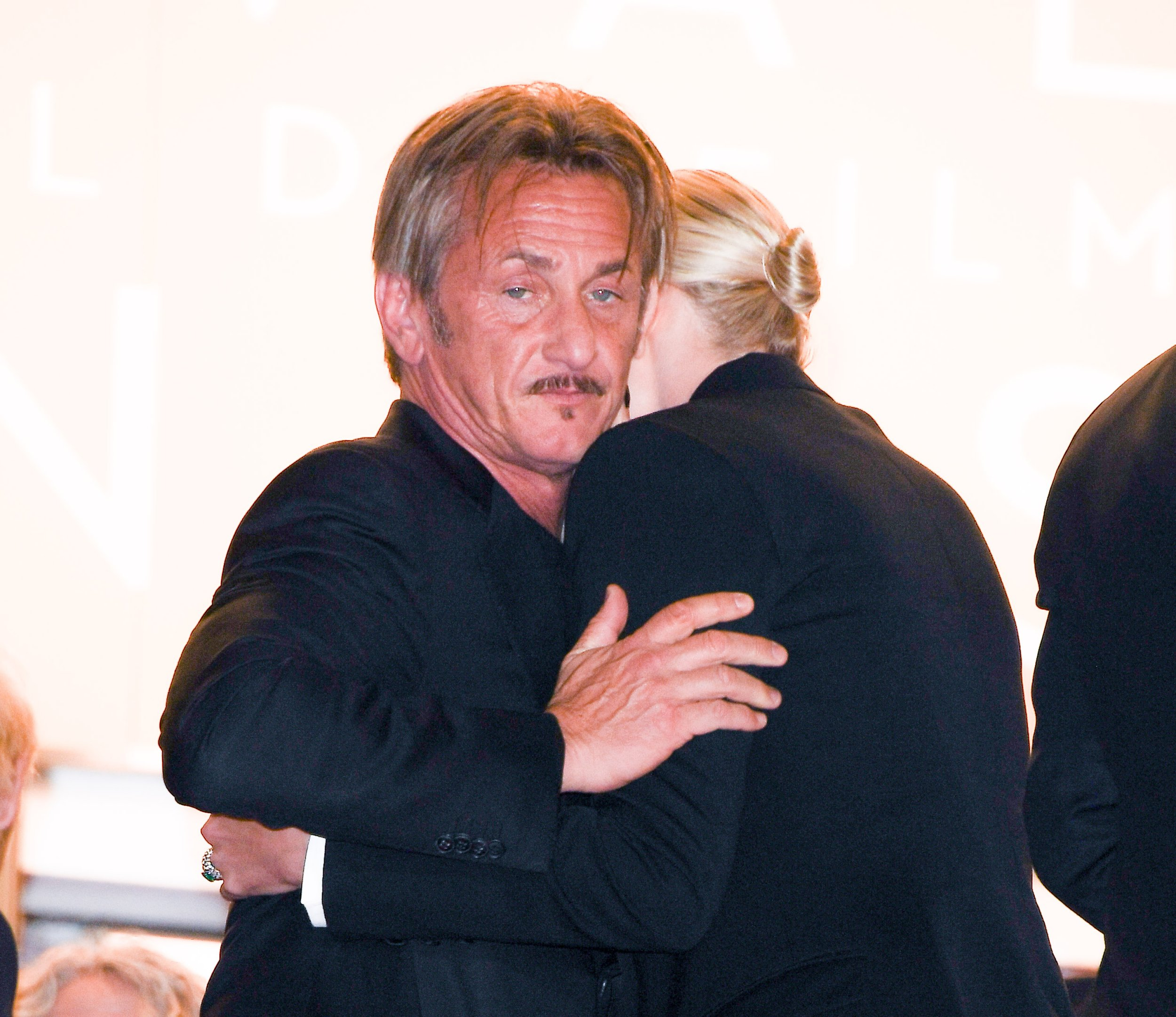 CANNES, FRANCE - MAY 20: Sean Penn embraces Charlize Theron as they attend the screening of 'The Last Face' at the annual 69th Cannes Film Festival at Palais des Festivals on May 20, 2016 in Cannes, France. (Photo by George Pimentel/WireImage)