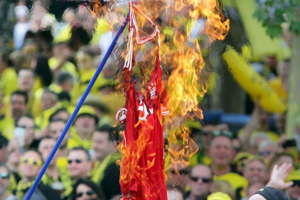Borussia Dortmund fans burn a Mats Hummels Bayern Munich shirt ahead of DFB Pokal Final in Berlin