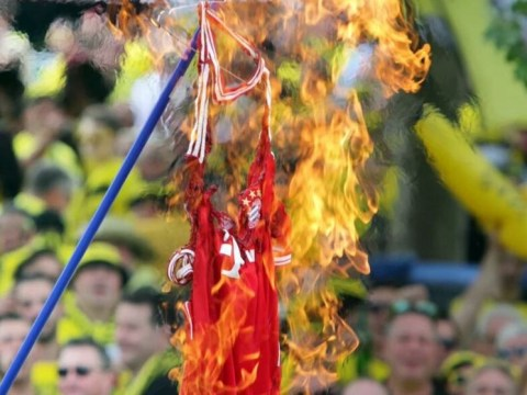 Borussia Dortmund fans burn a Mats Hummels Bayern Munich shirt ahead of DFB Pokal Final in Berlin