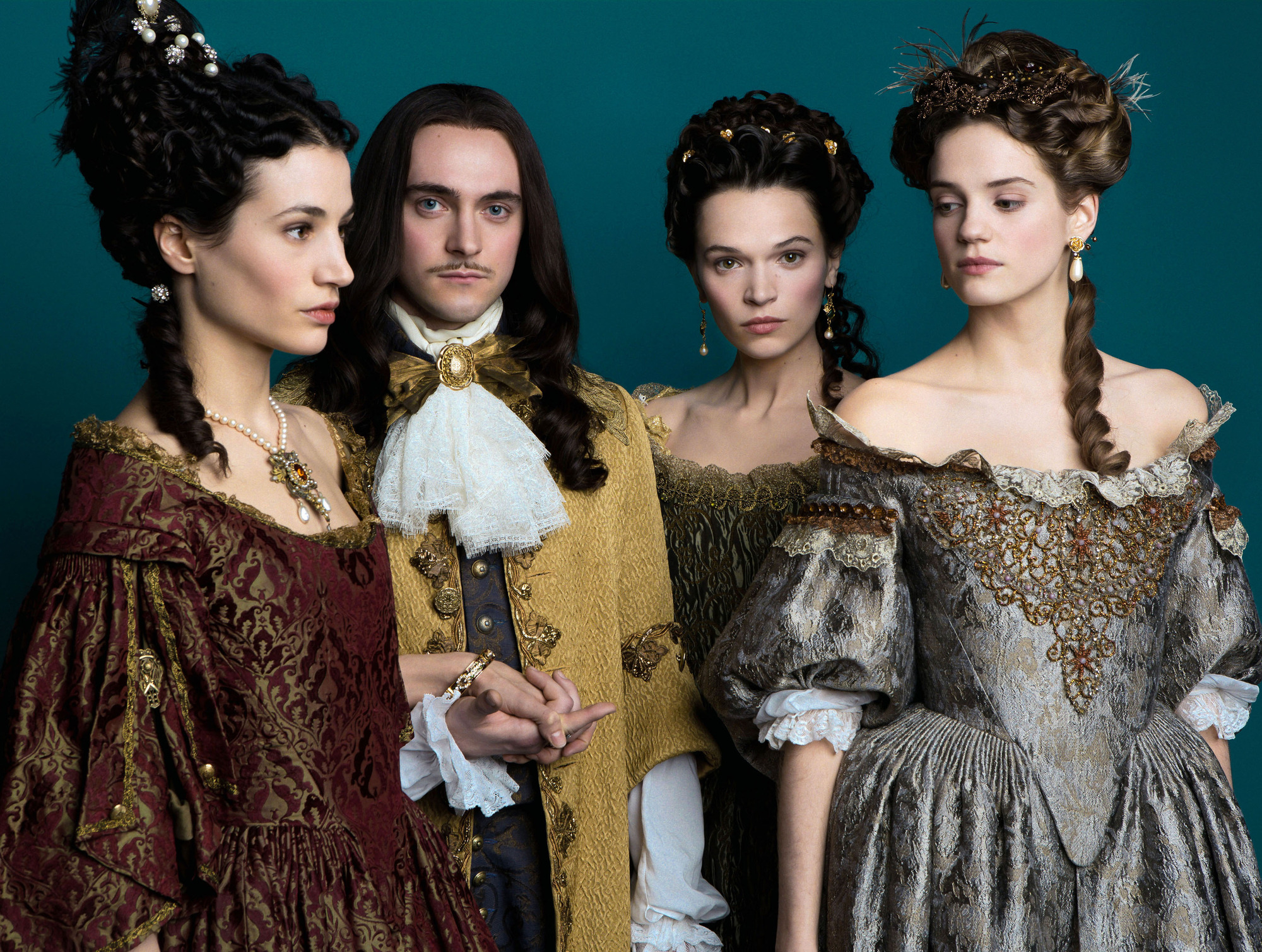 WARNING: Embargoed for publication until 00:00:01 on 24/05/2016 - Programme Name: Versailles - TX: n/a - Episode: n/a (No. n/a) - Picture Shows: Marie-Thérèse (ELISA LASOWSKI), Louis XIV (GEORGE BLAGDEN) , Madame de Montespan (ANNA BREWSTER), Henriette (Noémie Schmidt) - (C) Thibault Grabherr for Canal+ - Photographer: Thibault Grabherr