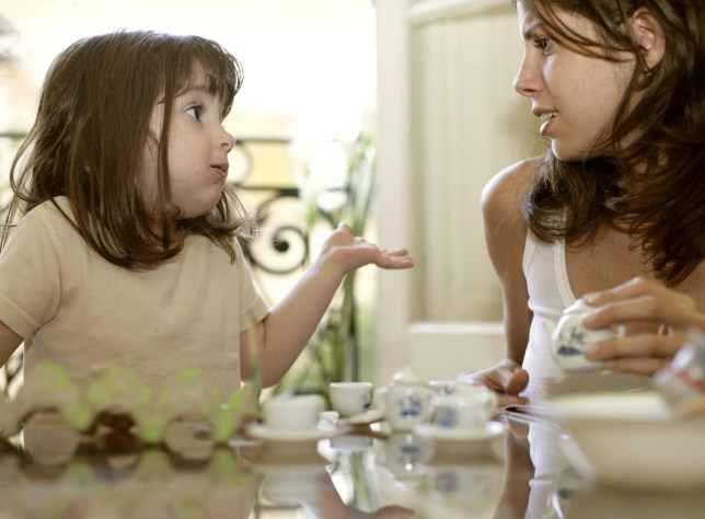 Mother and daughter (2-4) having tea and talking