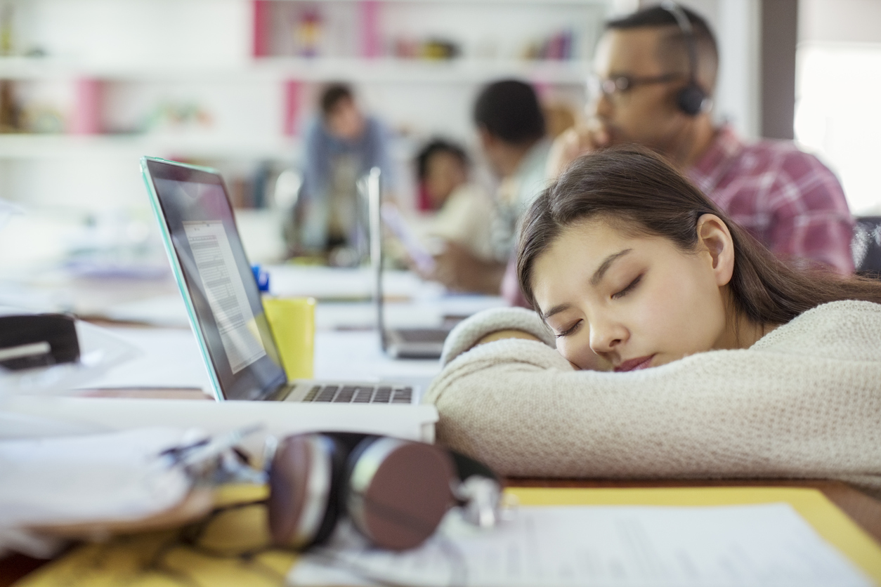 Woman sleeping at conference table