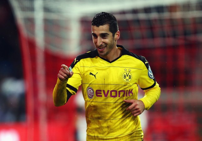 STUTTGART, GERMANY - FEBRUARY 09: Henrikh Mkhitaryan of Borussia Dortmund celebrates as he scores their third goal during the DFB Cup Quarter Final match between VfB Stuttgart and Borussia Dortmund at Mercedes-Benz Arena on February 9, 2016 in Stuttgart, Germany. (Photo by Alex Grimm/Bongarts/Getty Images)