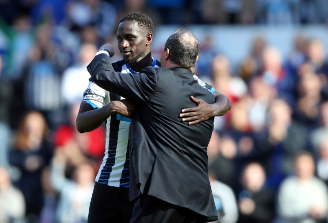Newcastle United's Spanish manager Rafa Benitez (R) embraces Newcastle United's French midfielder Moussa Sissoko after the English Premier League football match between Newcastle United and Tottenham Hotspur at St James' Park in Newcastle-upon-Tyne, north east England on May 15, 2016. Newcastle won the game 5-1. / AFP / Scott Heppell (Photo credit should read SCOTT HEPPELL/AFP/Getty Images)