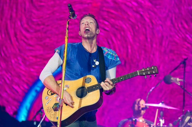 GLASTONBURY, ENGLAND - JUNE 26: Chris Martin from Coldplay performs on The Pyramid Stage, Glastonbury Festival 2016 at Worthy Farm, Pilton on June 26, 2016 in Glastonbury, England. (Photo by Harry Durrant/Getty Images)