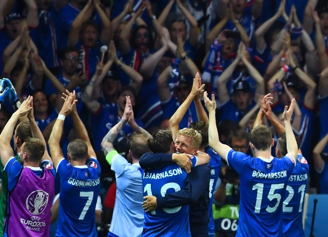 Iceland's coach Heimir Hallgrimsson (C) and his players celebrate after the Euro 2016 round of 16 football match between England and Iceland at the Allianz Riviera stadium in Nice on June 27, 2016. / AFP / ANNE-CHRISTINE POUJOULAT (Photo credit should read ANNE-CHRISTINE POUJOULAT/AFP/Getty Images)