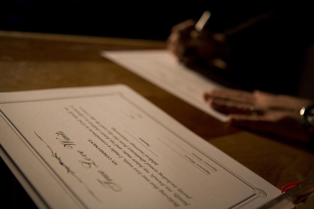 A purity ring ceremony participant signs a True Love Waits certificate (Picture: Getty)