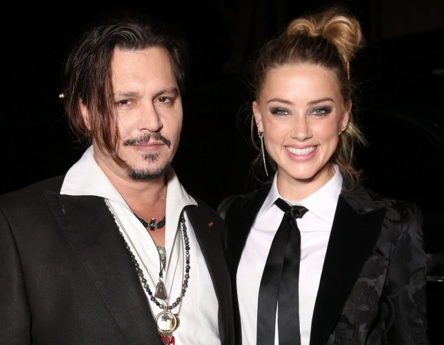 """Actress Amber Heard has applied for and been granted a domestic violence restraining order against husband, actor Johnny Depp. Heard filed for divorce less than a week ago after 15 months of marriage. WESTWOOD, CA - NOVEMBER 21: Johnny Depp and Amber Heard attend the premiere Of Focus Features' """"The Danish Girl"""" on November 21, 2015 in Westwood, California. (Photo by Todd Williamson/Getty Images)"""