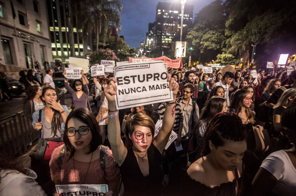 Mandatory Credit: Photo by Cris Faga/ZUMA Wire/REX/Shutterstock (5701062a) People take part in a protest against the gang-rape of a 16-year-old girl last week in a favela in Rio de Janeiro, in Paulista Avenue in Sao Paulo Protest after gang rape of girl, Sao Paulo, Brazil - 01 Jun 2016 Rio police arrested two men on May 30 and hunted four others in the alleged gang rape of an unconscious teenage girl that came to light in an online video that shocked Brazil. Social networks erupted with outrage over the video posted on May 21 featuring the girl naked on a bed and the apparent rapists bragging that she had been raped by more than 30 men.