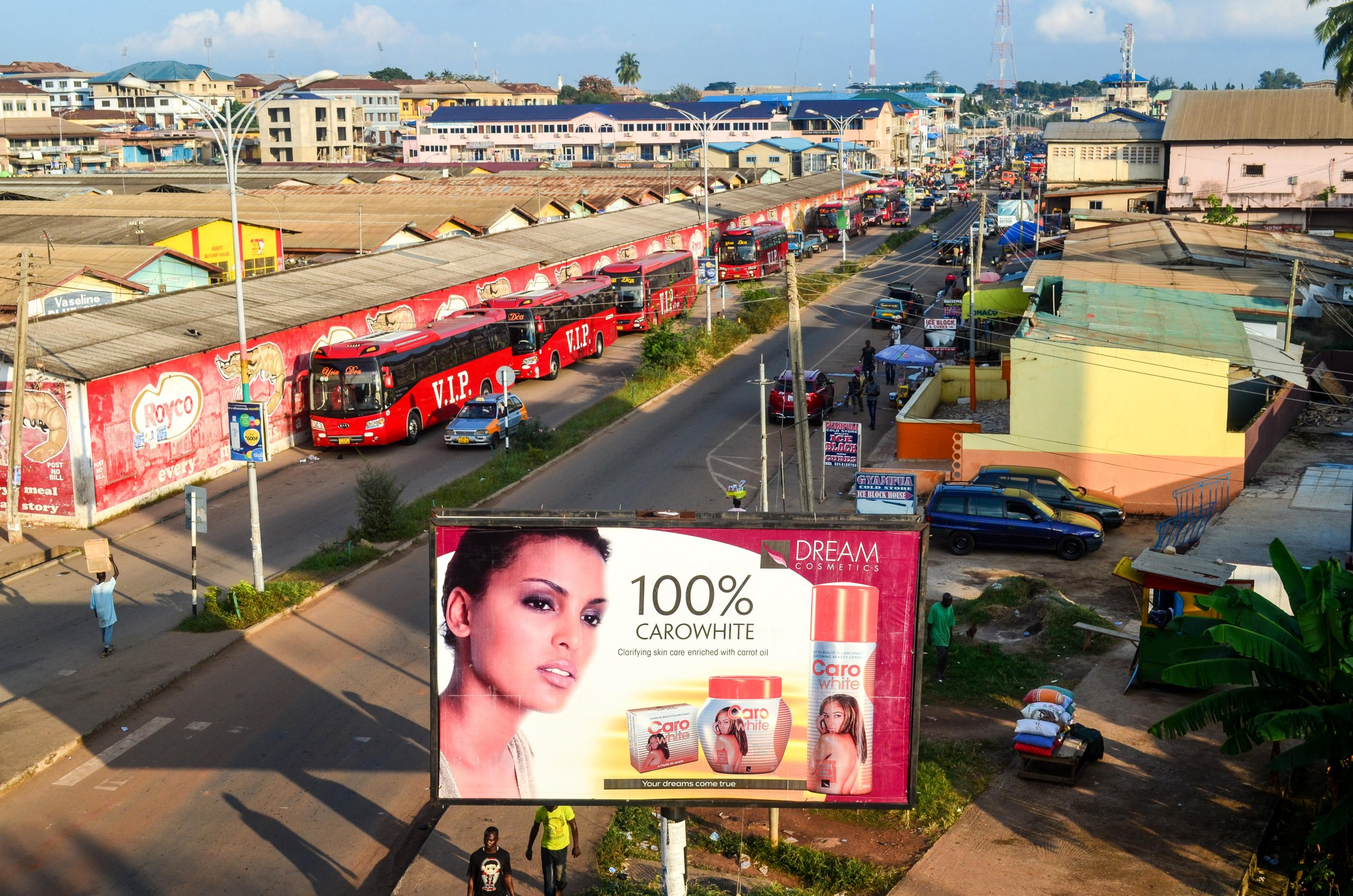 F00CY2 Aerial view of Kumasi, Ghana, with an ad of a skin whitening cosmetic product