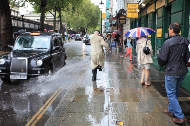 After a heavy rain in London city, streets were plenty of puddles; being a pedestrian had its risks.