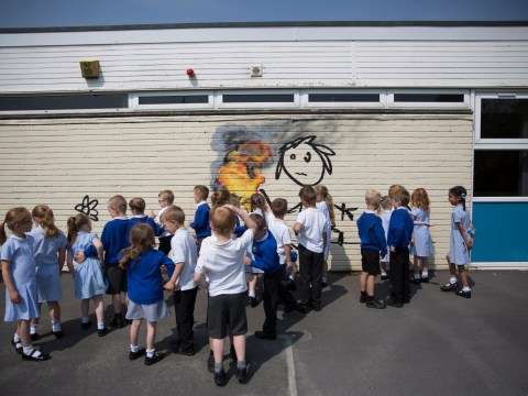 Banksy leaves painting on wall of primary school as a thank-you present