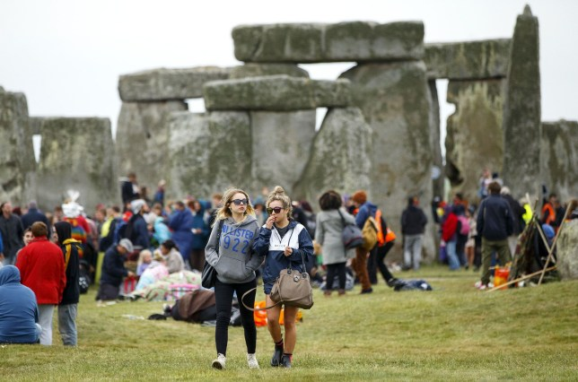 Mandatory Credit: Photo by Tolga Akmen/LNP/REX/Shutterstock (4850890j)nRevellers take part in celebrations to mark the summer solstice at Stonehenge prehistoric monumentnSummer Solstice Festival at Stonehenge, Salisbury, Britain - 21 Jun 2015nThousands of revellers gather at the 5,000 year old stone circle in Wiltshire to see the sunrise on the Summer Solstice dawn. The solstice sunrise marks the longest day of the year in the Northern Hemisphere.n