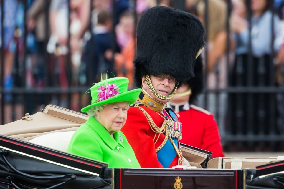 Crowds watch as HM The Queen and the Duke of Edinburgh attend the Trooping the Colour in London, June 11 2016. See SWNS story SWTROOP; Almost fifteen hundred soldiers from the Household Division will be on parade to mark the Queenís Official 90th Birthday on 11th June 2016 on Horse Guards Parade, at the ceremony known as Trooping the Colour. All the Royal Colonels will accompany Her with The Prince of Wales, The Duke of Cambridge, and The Princess Royal riding on the parade. This year, the Colour being trooped in the presence of Her Majesty The Queen is that of Number 7 Company Coldstream Guards. The Field Officer in Brigade Waiting, Lieutenant Colonel James Thurstan, Coldstream Guards, will command the Parade. The Soldiers will be on parade in the traditional ceremonial uniforms of the Household Cavalry, Royal Horse Artillery, and Foot Guards. The musicians in the Household Cavalry Band and the Drum Majors will be in their priceless Gold Coats. There will be more than 300 horses on parade, and musicians from all the Household Division Bands & Corps of Drums will march and play as one. The famous Drum Horses of the Household Cavalry Band carrying priceless antique solid silver drums weighing 80lbs each will also be on parade.