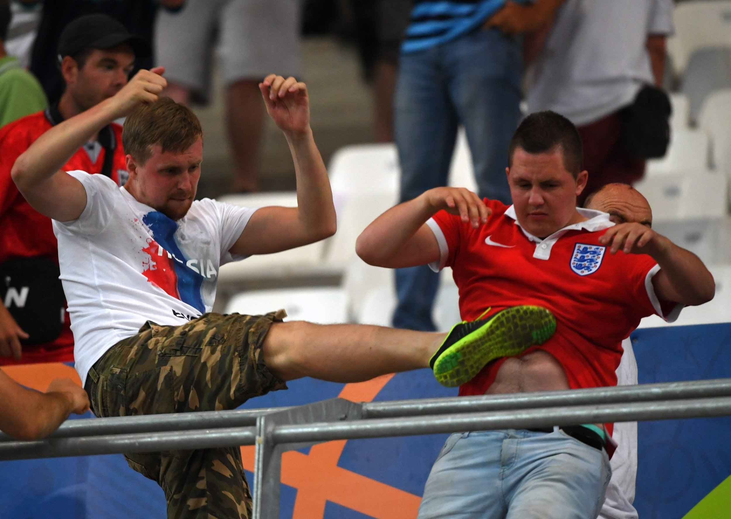 epaselect epa05358400 A Russia supporter (L) clashes with an England supporter (R) in the stands during the UEFA EURO 2016 group B preliminary round match between England and Russia at Stade Velodrome in Marseille, France, 11 June 2016. (RESTRICTIONS APPLY: For editorial news reporting purposes only. Not used for commercial or marketing purposes without prior written approval of UEFA. Images must appear as still images and must not emulate match action video footage. Photographs published in online publications (whether via the Internet or otherwise) shall have an interval of at least 20 seconds between the posting.) EPA/PETER POWELL EDITORIAL USE ONLY