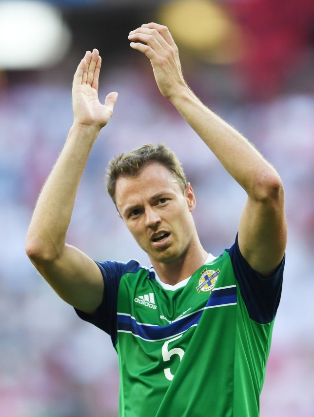 NICE, FRANCE - JUNE 12: Jonny Evans of Northern Ireland applauds the supporters after his team's 0-1 defeat in the UEFA EURO 2016 Group C match between Poland and Northern Ireland at Allianz Riviera Stadium on June 12, 2016 in Nice, France. (Photo by Laurence Griffiths/Getty Images)