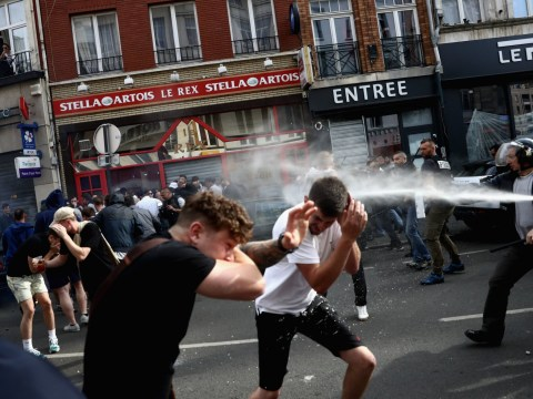 Police fire tear gas as England and Russia fans clash yet again at Euro 2016