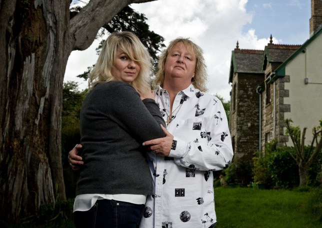 Janie and Lisa Davey-Collins at their home in Cornwall. A furious lesbian couple have accused the church of discrimination after it refused to bless their marriage - less than a MONTH before their planned ceremony. See story SWLESBIAN. Lisa and Janie Davey-Collins married at their local registry office in March and planned a celebration for friends and family in the garden of their home. They asked local curate Reverend Heather Aston to attend and bless their wedding, but the church has refused to acknowledge their marriage. The angry couple were told last week that Reverend Aston would not attend the event in Manaccan, Cornwall, even without wearing her dog collar. The Diocese of Truro told them that law changes on same sex marriages did not apply to the Anglican church. But Lisa, 54, said she and Janie, 35, are dismayed and distraught that their plans had been ruined. And they accused the church of discriminating against gay people.